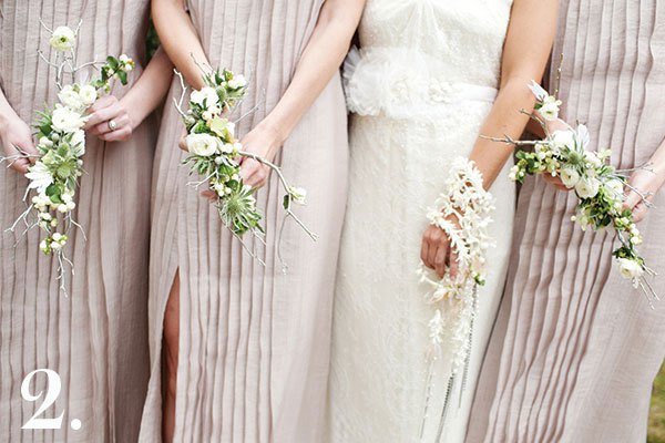 The handwork design of these bouquets amazes me. The bride was no stranger to couture so her flowers needed to reflect her high-fashion sensibility. To complement her bridesmaids' J. Mendel gowns, we painstakingly cut manzanita branches to fit the wrist and silver-leafed them before attaching stephanotis, tuberose blossom, and Brunea Berry with sterling silver wire. Although she wasn't Catholic, the bride loved the idea of carrying a rosary so we threaded gardenia, majolica roses, and silver lamb's ear with sterling silver wire and beading to create that effect. I'm thrilled when clients want to think outside the box. | Photo by Perez Photography