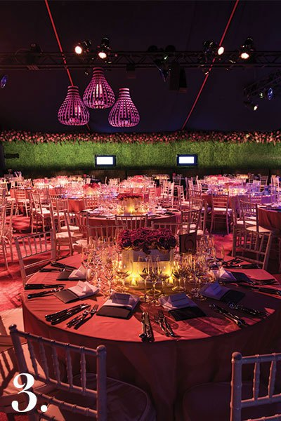 For the past several years, I've donated my services to the TWO X TWO for AIDS and Art annual gala and auction at the Rachofsky House in Dallas. For their 2012 benefit, we employed a navy blue and fuchsia palette—the pairing was so sharp. The back wall of the tent was like a tidal wave of boxwood with a top-cuff of pink hydrangea and heather. For the banquette that lined the wall, we photographed the boxwood and digitized the image onto fabric that was used to slipcover the cushions. You could hardly tell where the wall ended and the seating began. | Photo by Roderick Pena