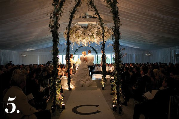 This was a really beautiful couple and we wanted all eyes on them. Without an altar, we needed to designate a focal point so we designed a giant ring of white hydrangea, garden roses, and Hawaiian dendrobium and suspended it above them. It crowned them as they said their vows. |Photo by Stephen Karlisch and Steve Wrubel