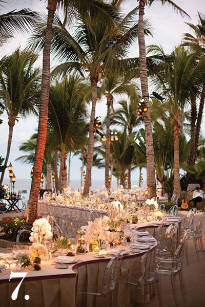 For this Cabo wedding, we custom-designed a 165-foot-long table to wind around the palm trees of the pool deck. Having that single table connected guests and provided an intimate feeling. The scenery was so inherently beautiful that we didn't need much to capture a luxurious, beachy vibe. | Photo by Stephen Karlisch and Steve Wrubel