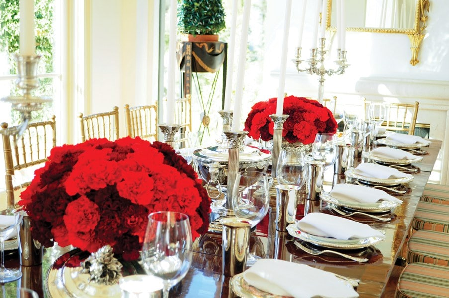 """""""For Christmas Eve dinner, I always want the flowers to be super special. These were done by my talented friend David Jones,"""" says Hitz."""