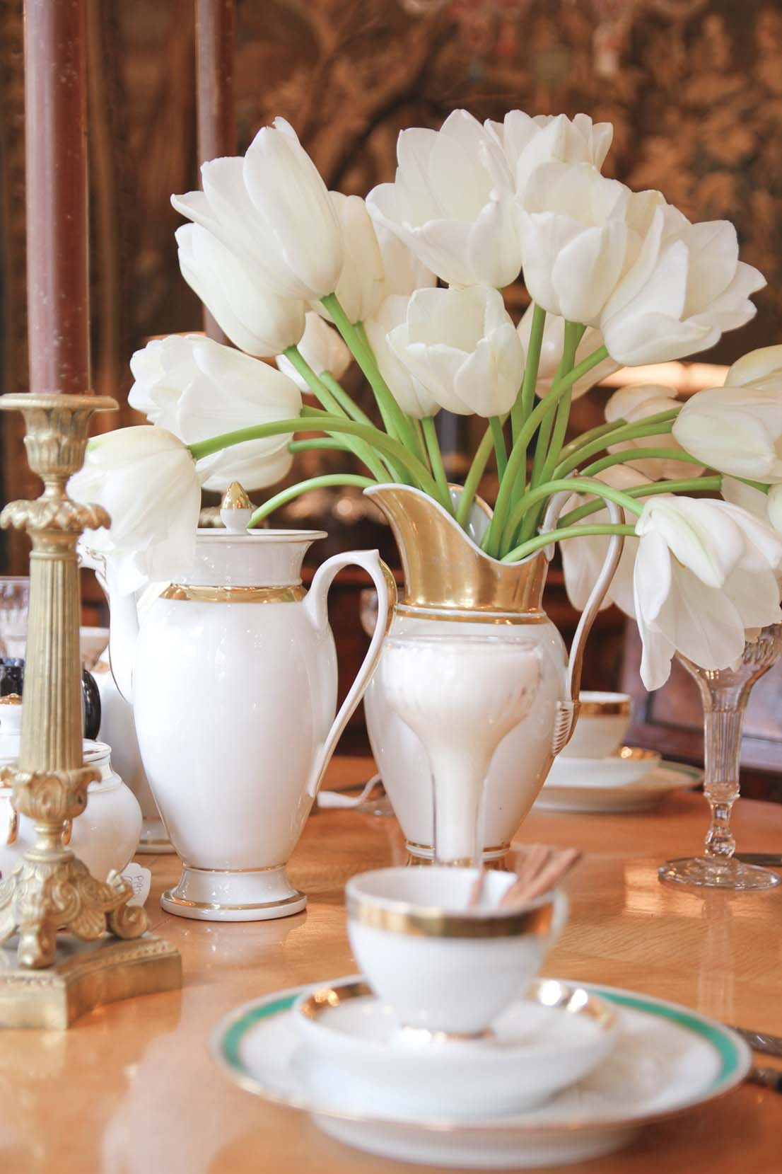 white tulips in an antique pitcher