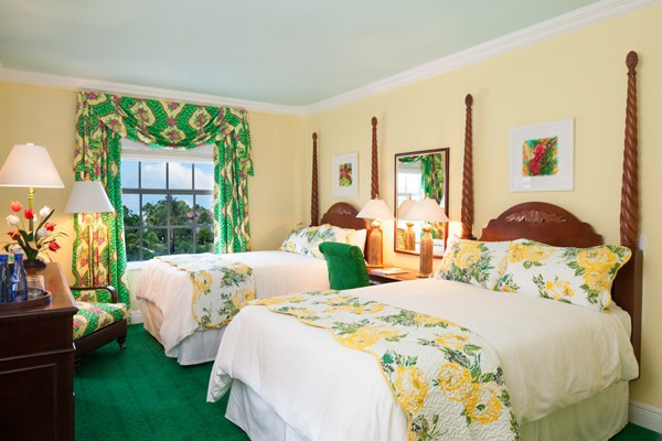 An abundantly floral guest room. Photo courtesy of Colony Hotel