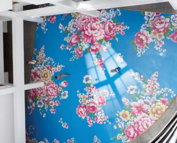 Overhead view of the floral floor painting by artist Michael Lin, titled Utah Sky 2065-40 (blue curve), at the High Museum of Art