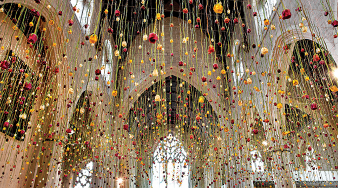 In Rebecca Louise Law's 3,000-flower installation in London's Garden Museum, roses rained down from the cathedral ceiling. Photo cour- tesy of Rebecca Louise Law.