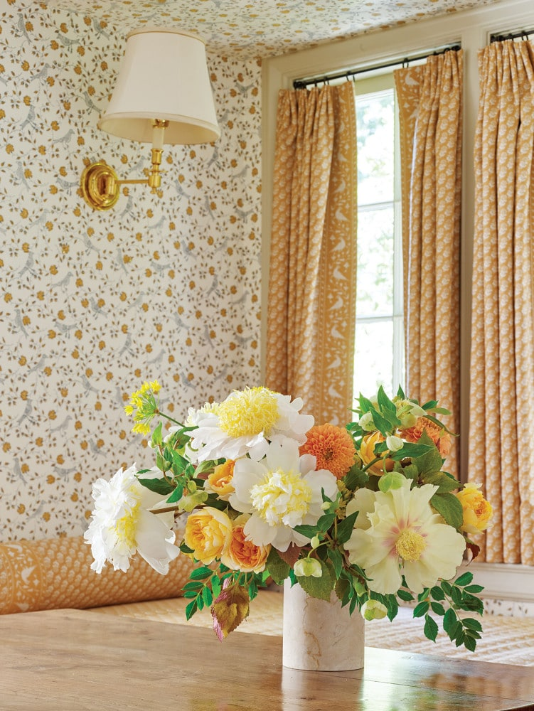 yellow flower arrangement by Bows & Arrows; interiors by Cathy Kincaid