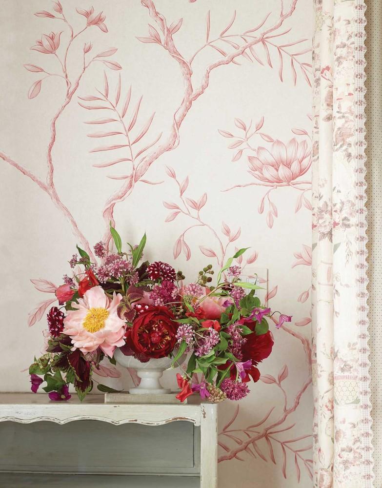 red and pink flower arrangement; pink floral wallpaper
