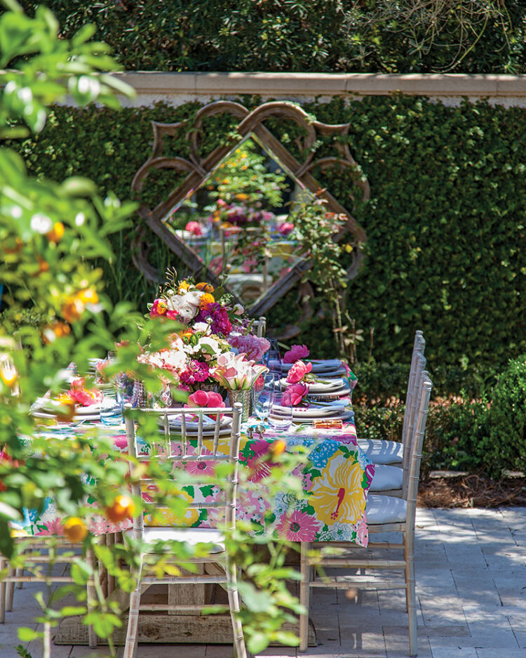 Tables in The Cloister's Georgian Room garden werecovered with cloths madeof Lilly Pulitzer fabricand decorated with lusharrangements created byThe Vine.