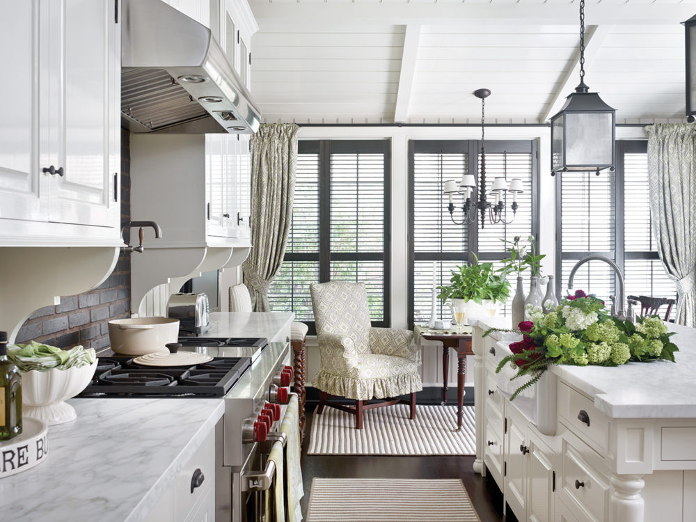 A gourmet kitchen with farmhouse sink deep enough for some serious flower arranging is also warmed with antiques, textures, and subtle prints.