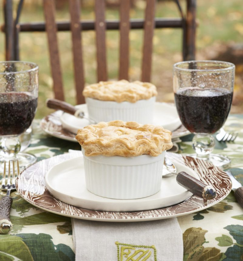 Chicken pot pie baked and served in individual ramekins at an al fresco fall gathering