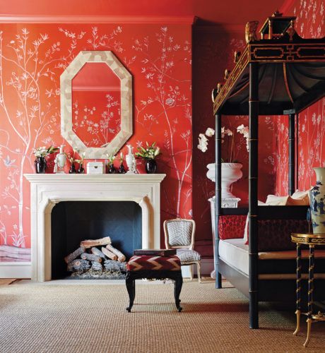 Ceylon et Cie's signature pagoda daybed becomes the perfect complement for a saturated de Gournay chinoiserie wallpaper in a rich vermilion red. | Photo by Stephen Karlisch