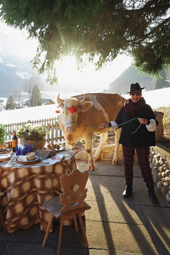 Michelle Nussbaumer at her Swiss chalet with her milk cow, Cindy. | Photo by Melanie Acevedo