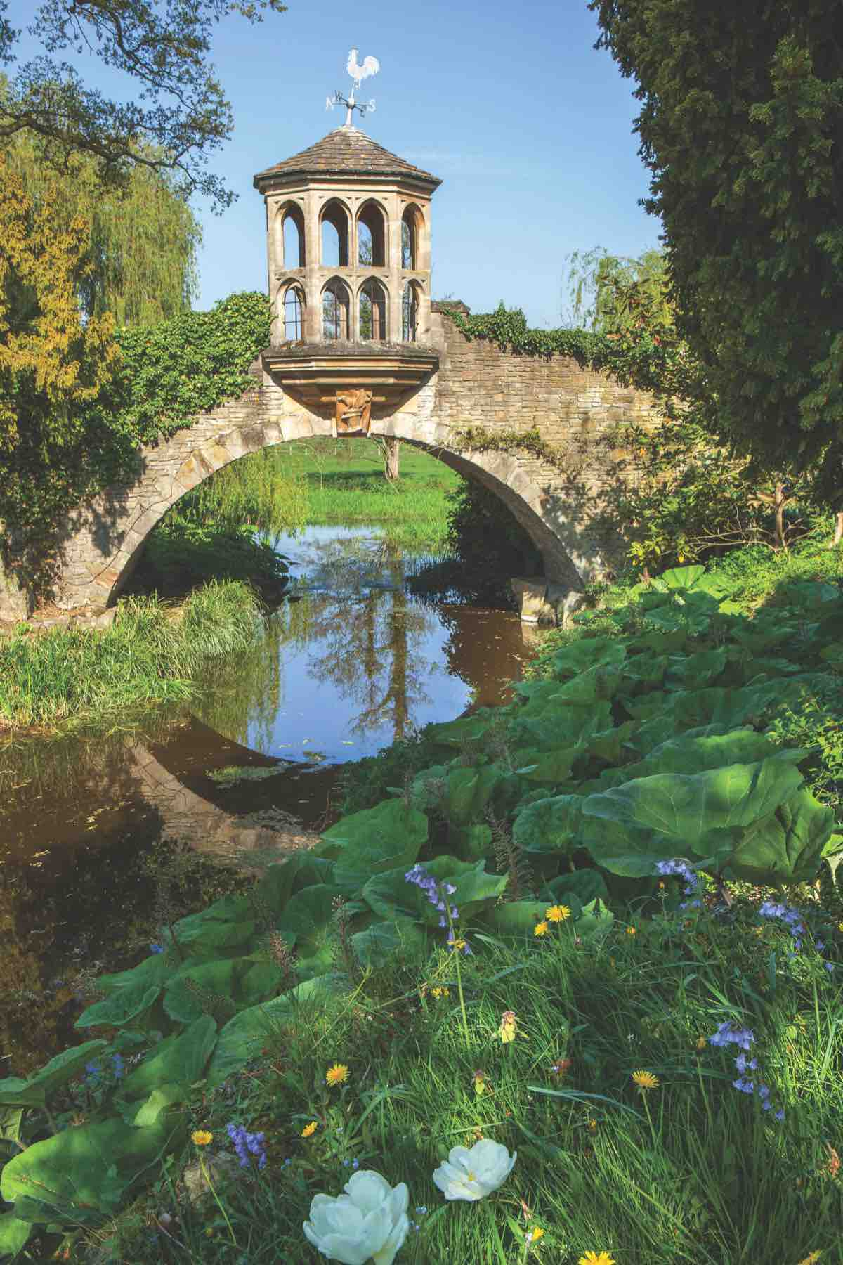 Folly on stone bridge over stream