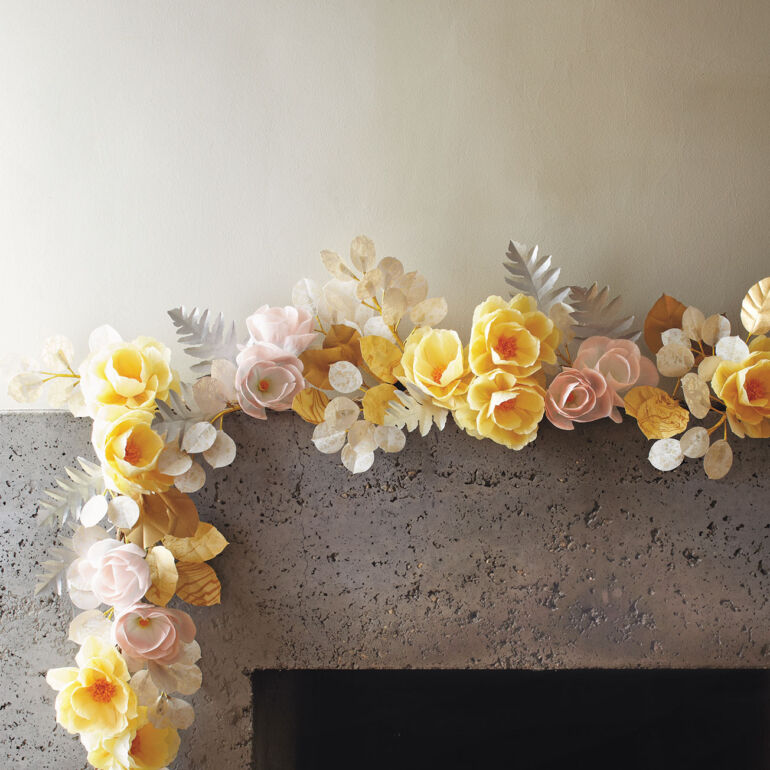 pale yellow, pink, and white garland of paper flowers