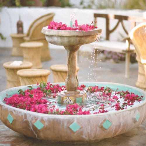 Two tiered circular fountain with aqua tile accents