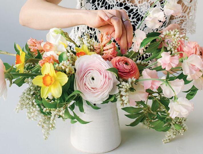 munster rose ranunculus daffodil arrangement