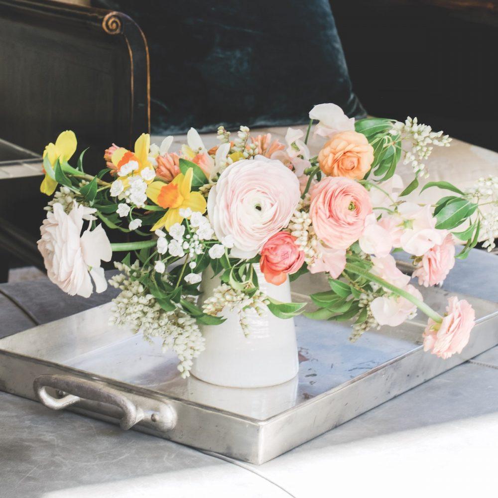Cloni ranunculus, often called Clooney ranunculus, in a floral arrangement