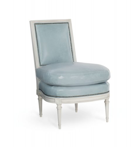 Armless chair with a white wood frame and light blue leather upholstery