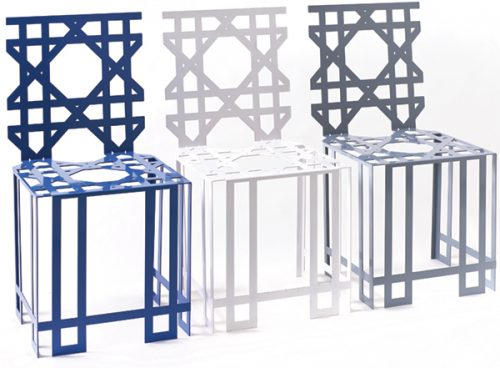 three chairs, each a different color - blue, white and gray