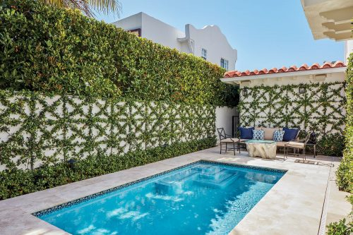 Photo of a courtyard pool. The trellis that garden designer Fernando Wong attached to the surrounding walls features a grid of squares crisscrossed by diagonal bars.