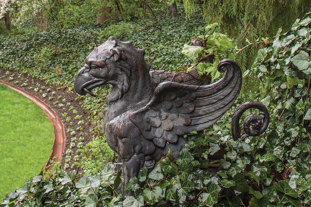 Photo of gargoyle at Melissa McGrain's garden in Pittsford, New York
