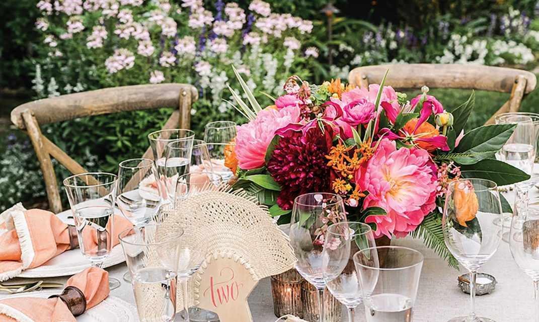 Miller and Barrie love to mix metals, such as lustrous gold flatware, hammered copper napkin rings, and mercury glass votive holders.
