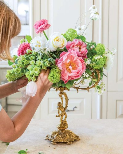 Step 12: finish the floral arrangement with white tulips
