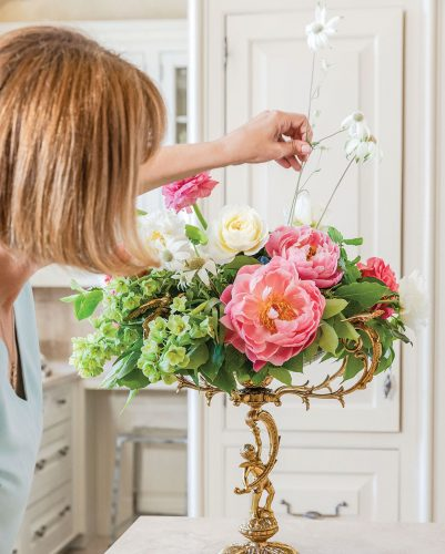 Step 9: Destiny-Pinson adds flannel flowers to the floral arrangement
