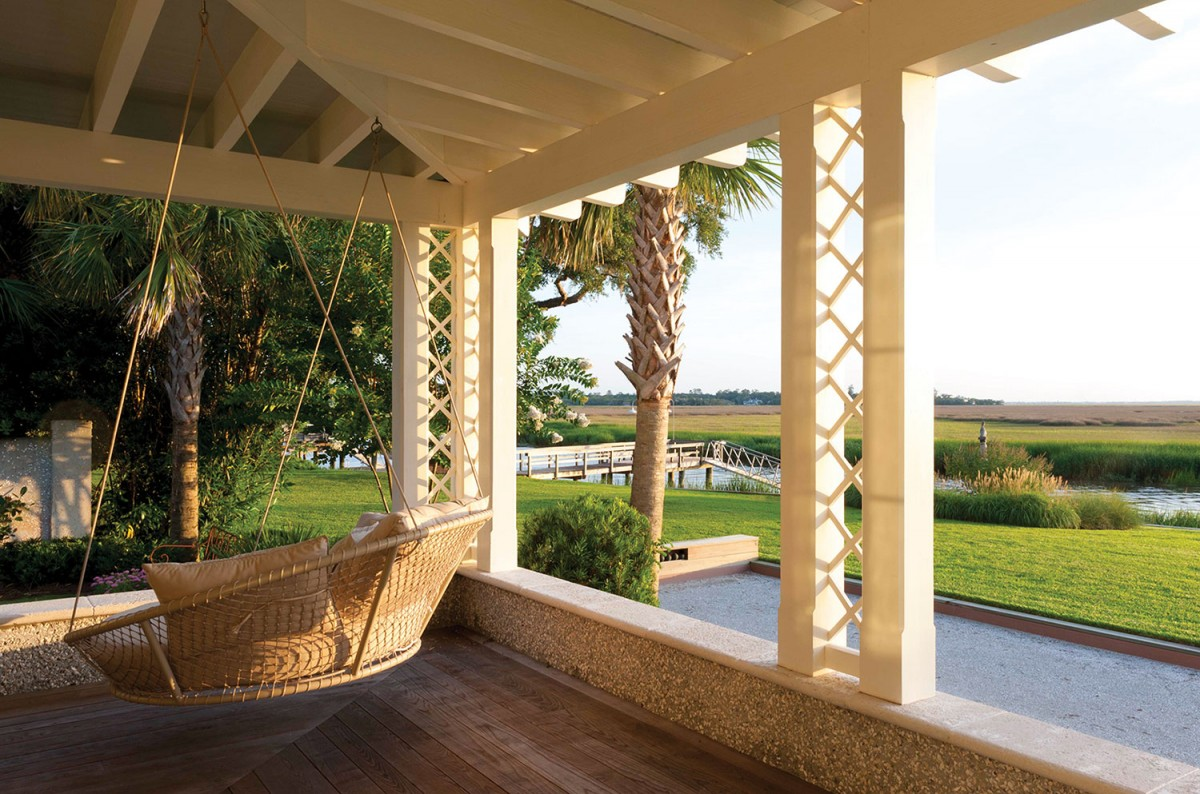 A swing on the veranda invites guests to linger and enjoy views of the marsh