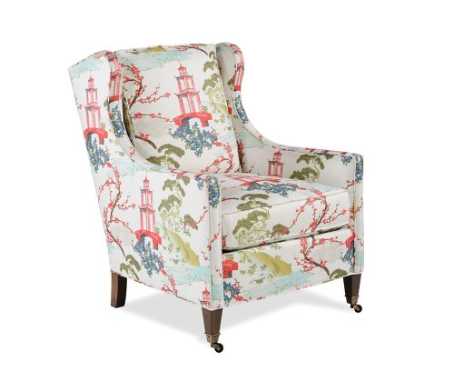 wingchair with pagoda motif upholstery featuring a white background, red pagodas and cherry blossom branches, blue flowers, and green trees