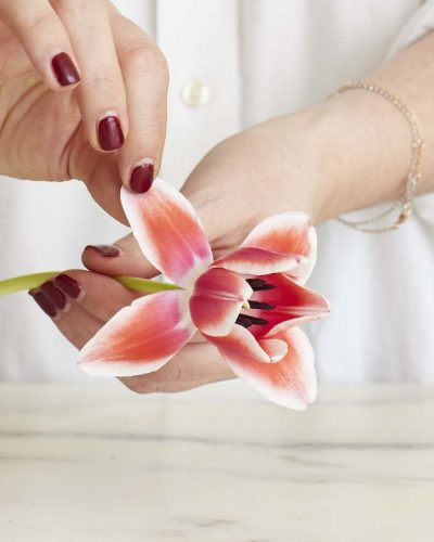 Mimi Brown gently opens a tulip manually