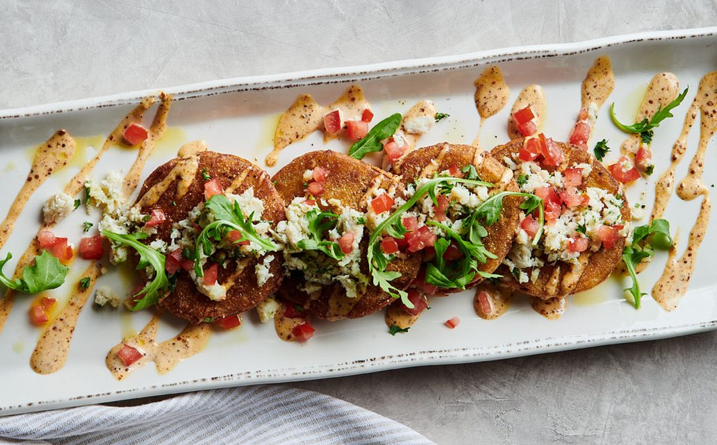 Chef Bancroft's Fried Green Tomatoes from the menu of farm-to-restaurant travel destination Acre in Auburn, Alabama