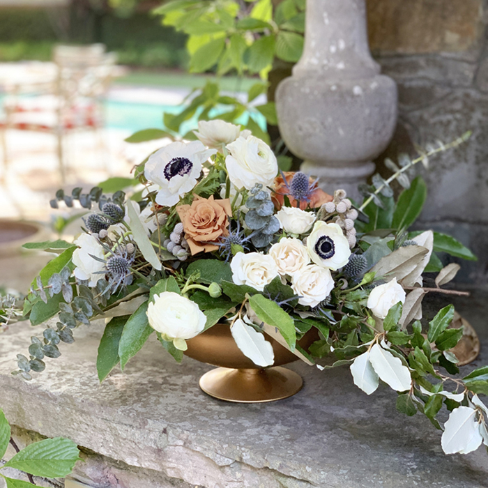 compote vase flower arrangement