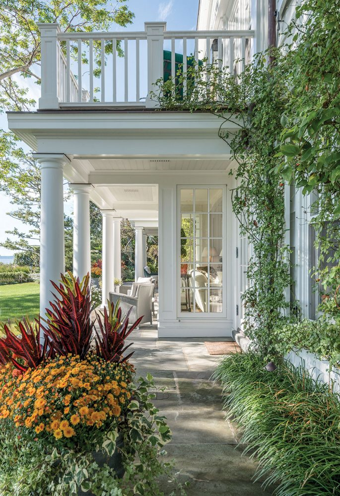 A two-level white columned porch from the pages of Renewing Tradition: The Architecture of Eric J. Smith