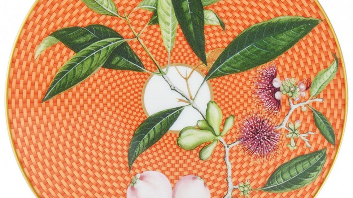 dessert plate with chrysanthemum-hued, geometric pattern behind a botanical motif