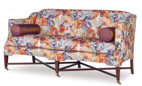 """Delicate sofa upholstered in a botanical pattern of blue and """"chrysanthemum orange"""" flowers"""