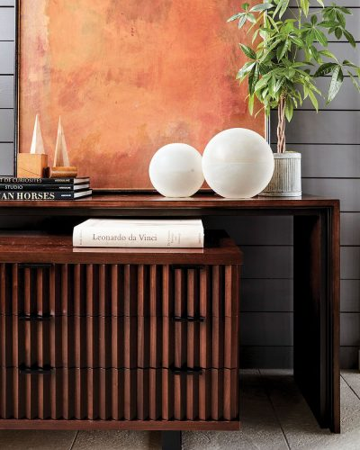 Modern chest with wood slates forming a linear motif across the front