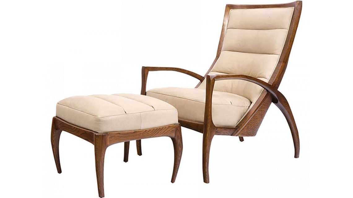 Modern lined chair and ottoman with off-white upholstery