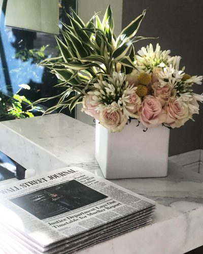 Stack of Wall Street Journals on a marble counter in the Post Oak Hotel lobby