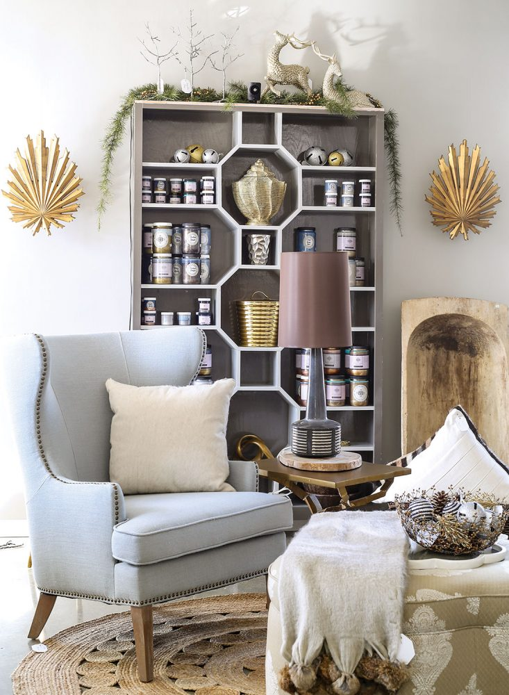 Best shopping in Richmond, Virginia: A store scene from Bridget Beari includes light blue wing chair, bookcase with the shelves arranged in a geometric pattern, and other unique decor.