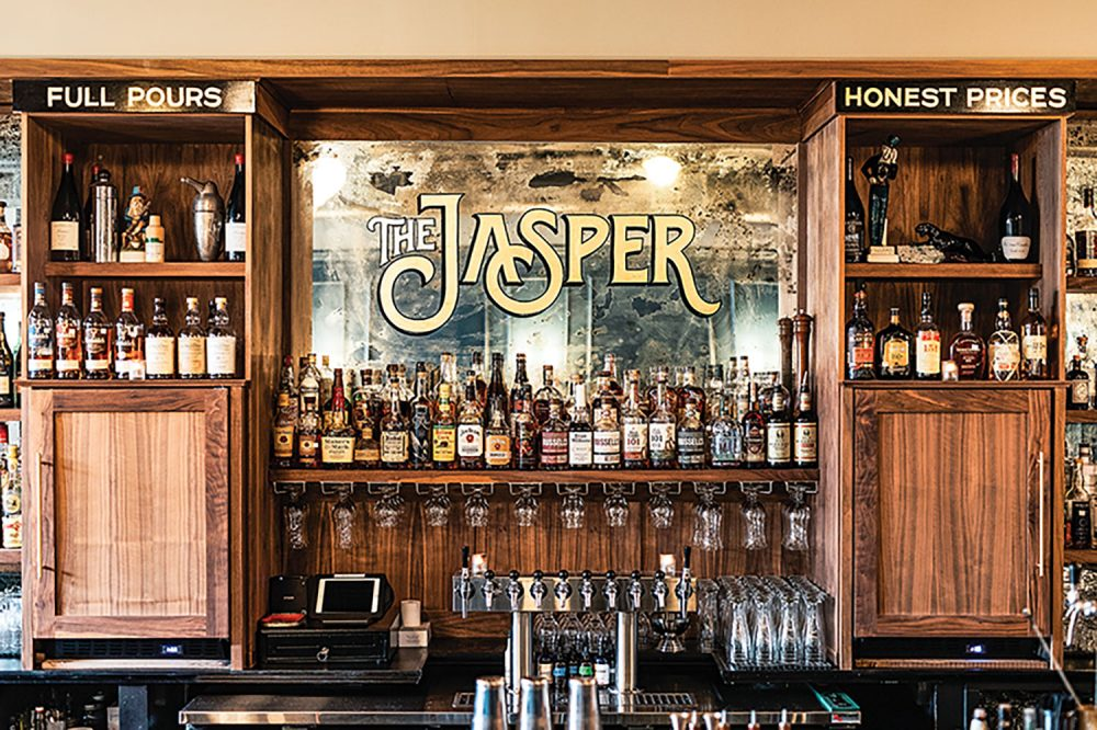 The mirrored and wooden bar of The Jasper