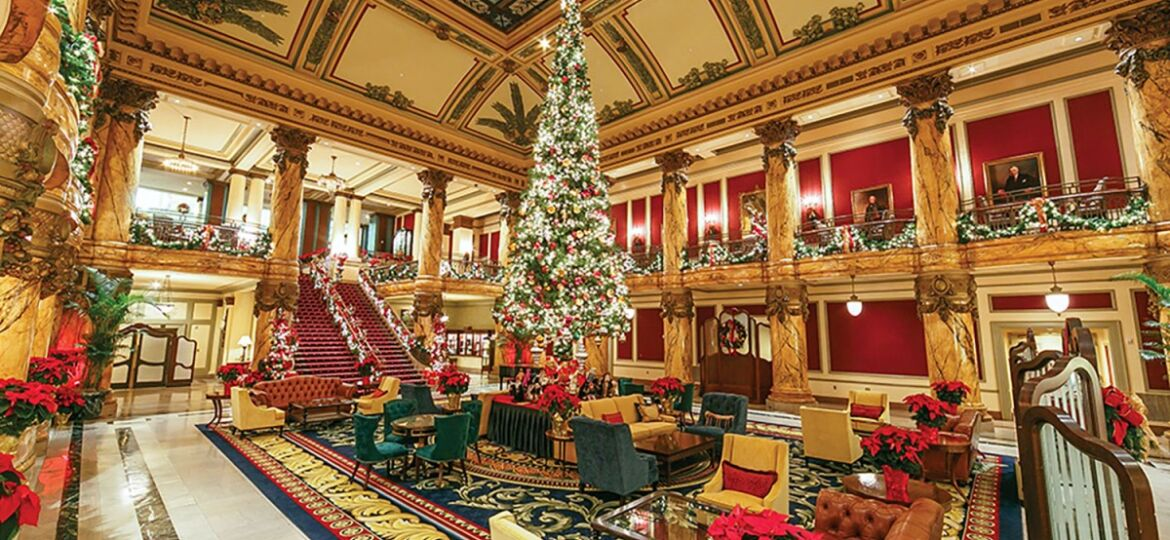 The ornate lobby of The Jefferson hotel in Richmond, Virginia, is decorated for the holiday season with a soaring traditional Christmas tree