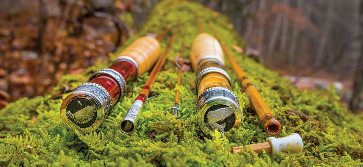 Detail of the reel seats of custom fly rods displayed on moss