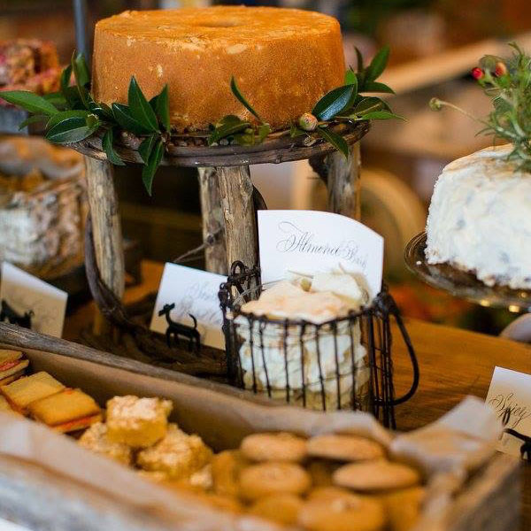 A holiday spread, including almond bark, pound cake, and other sweet and savory treats