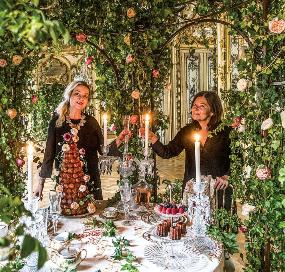 Laura Dowling with Parisian florist Anne Vitchen inside Vitchen's flower-covered, candlelit pavillion