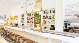 long marble bar inside Il Florista, a new restaurant in New York City