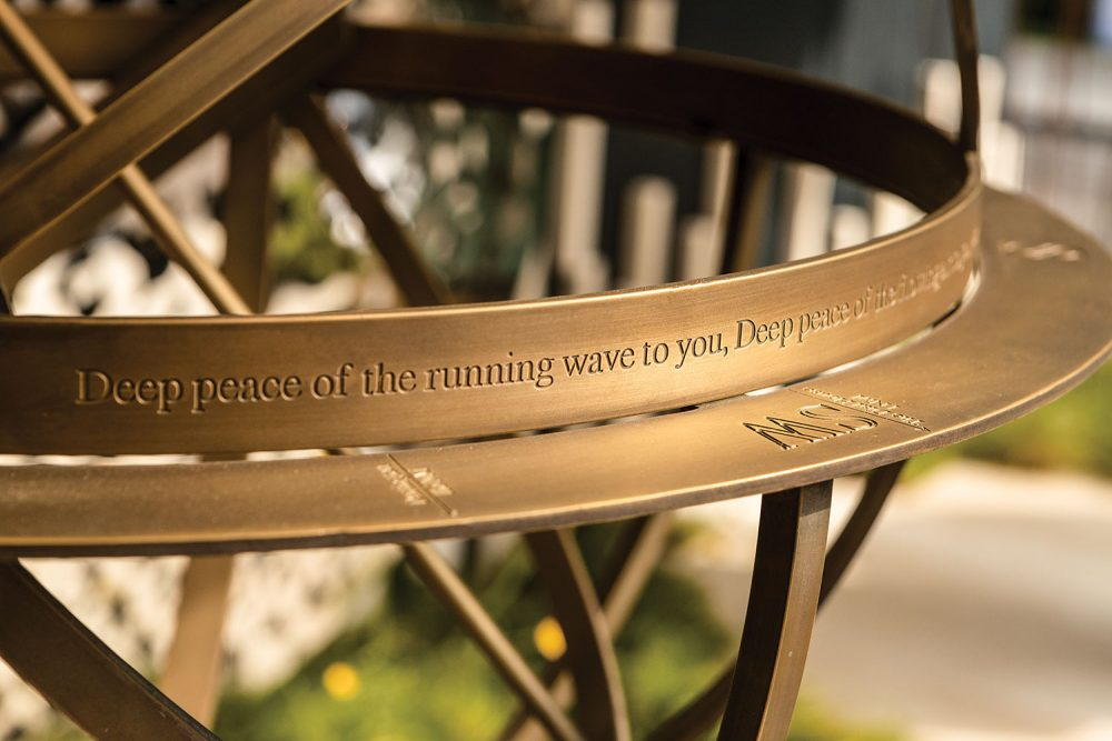 "The inscription reads ""Deep peace of the running wave to you."""