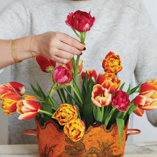 Step 4: Mimi Brown adds cerise parrot tulip to her arrangement last
