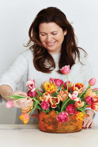 portrait of floral designer Mimi Brown arranging
