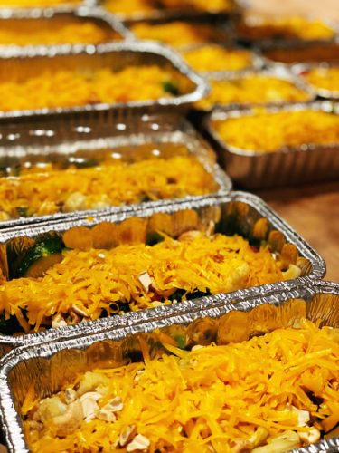 Trays of freezer-friendly meals in disposable aluminum loaf pans for Ynez Valley Food Relief Program